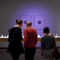 Photo of people looking at art