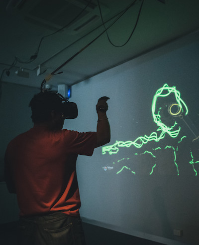 Man drawing in virtual reality